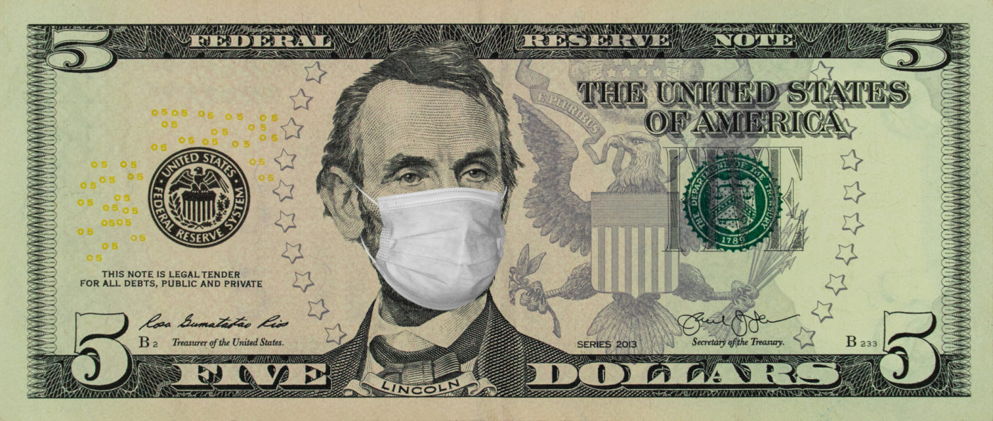 Viiden dolalrin seteli, jossa Abraham Lincolnilla kasvomaski.